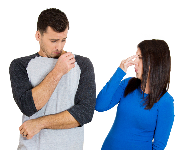 woman covering nose because the man stinks